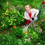 Woman watering her garden — Stock Photo