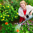 Woman watering her garden — Stock Photo #8149537