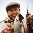 Happy mature fisherman - Stock Photo