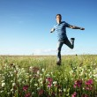 Man running on meadow — Stock Photo