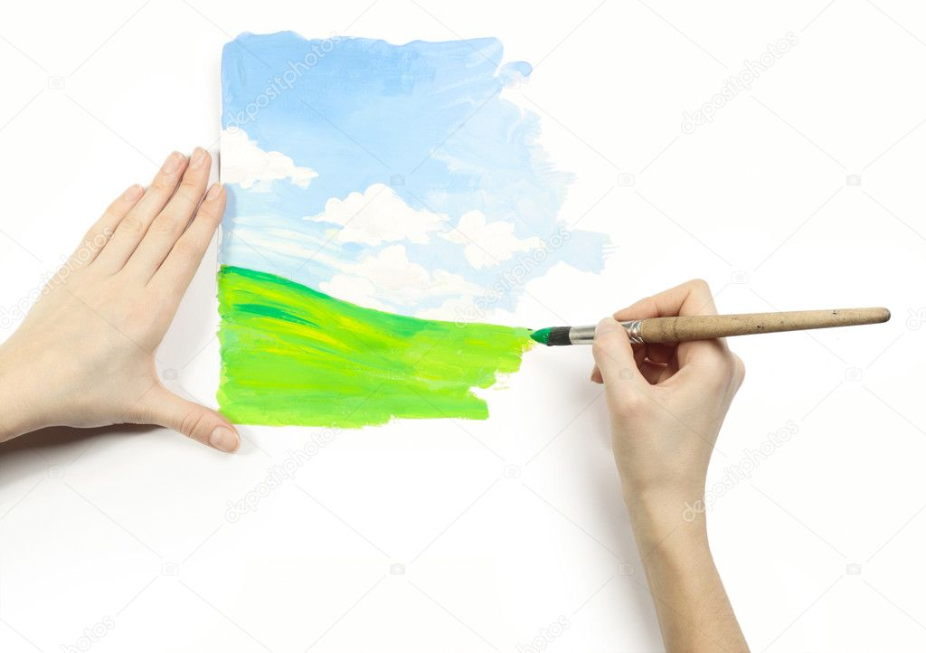 Hands with brush and fresh drawing on a white background — Stock Photo #8147852