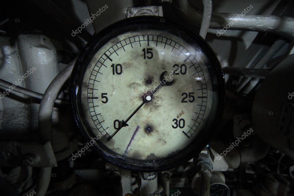 Obsolete manometer with scratches and dust with many tubes around it. Device is mounted on a real submarine. — Stock Photo #8148718