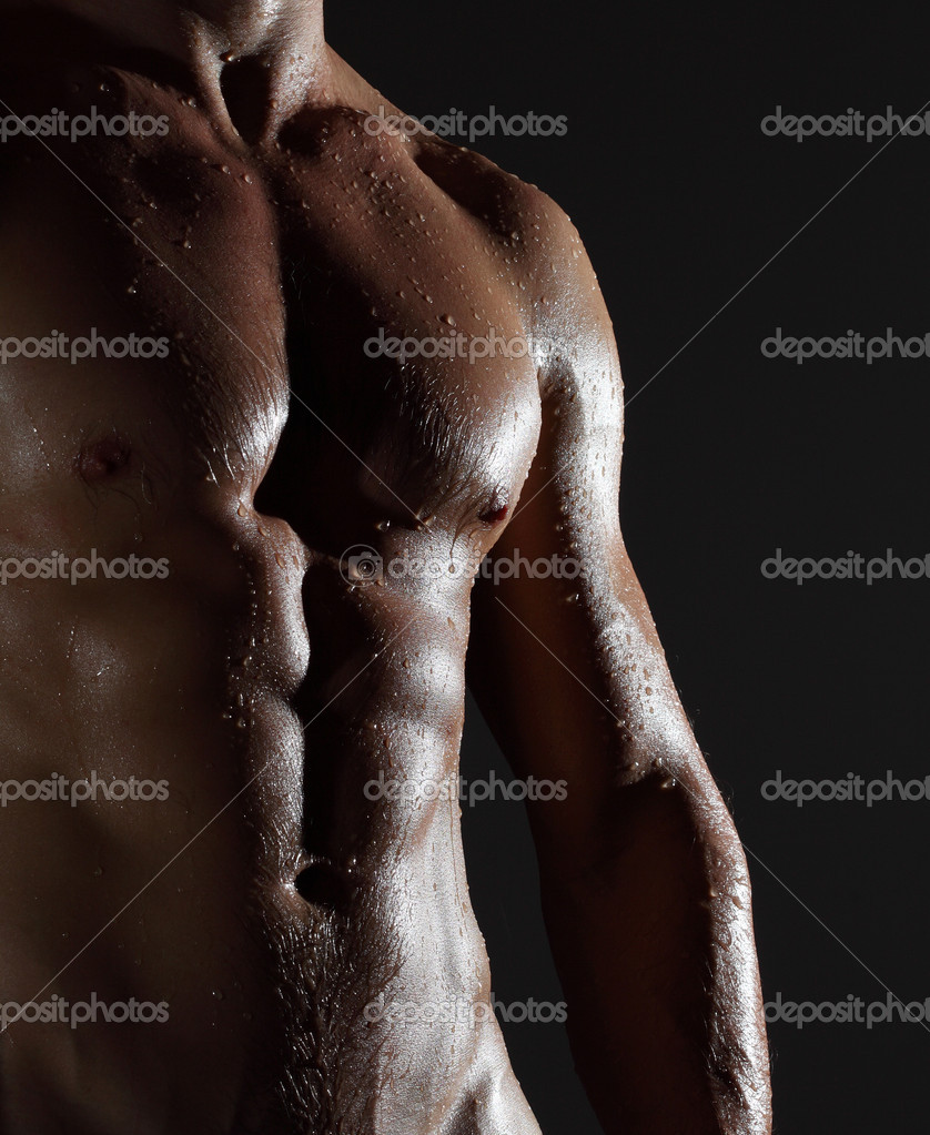 Part of a wet man's body on a gray background — Stock Photo #8149649