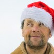 Smiling men with beard in santa's hat — Stock Photo #8151427
