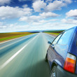 Car on a blurry road — Stock Photo