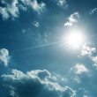 Sun with blue sky - Stock Photo