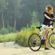 Woman on bike — Stock Photo #8157316