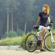 Woman on bike — Stock Photo #8157341