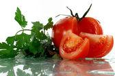 Tomato and parsley — Stock Photo