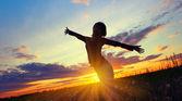Woman on sunset — Stock Photo