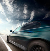 Motion blurred car — Stock Photo