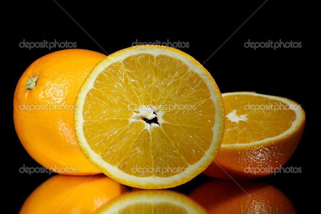 Group of oranges on black background — Stock Photo #8150038