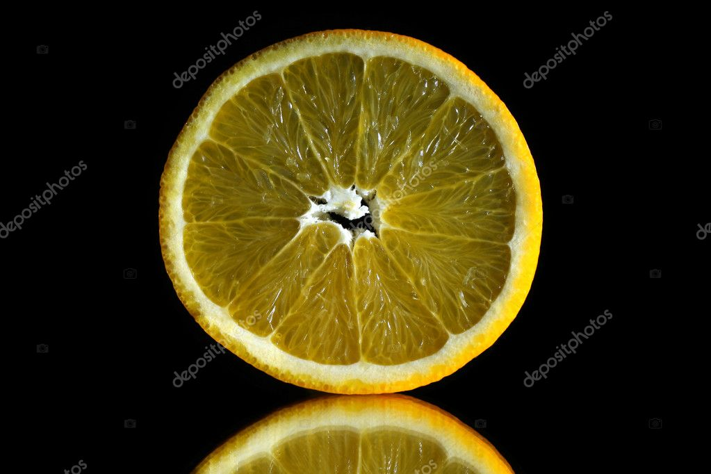 Orange slice on black background — Stock Photo #8150451