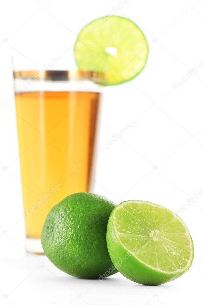 Limes and juice in glass  Stock Photo #8150513