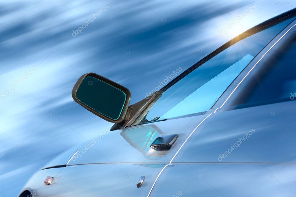 Blue car in motion with blurry clouds — Stock Photo #8151945