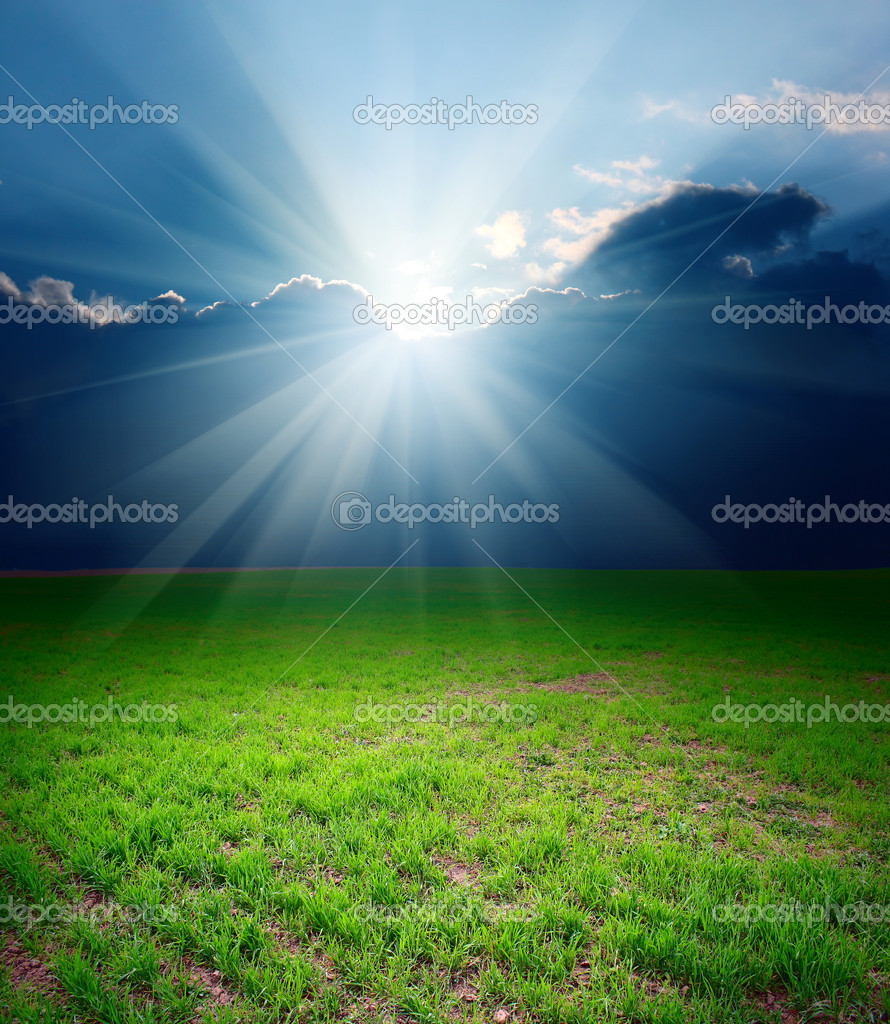 Storm clouds with sun over meadow with green grass — Stock Photo #8152415