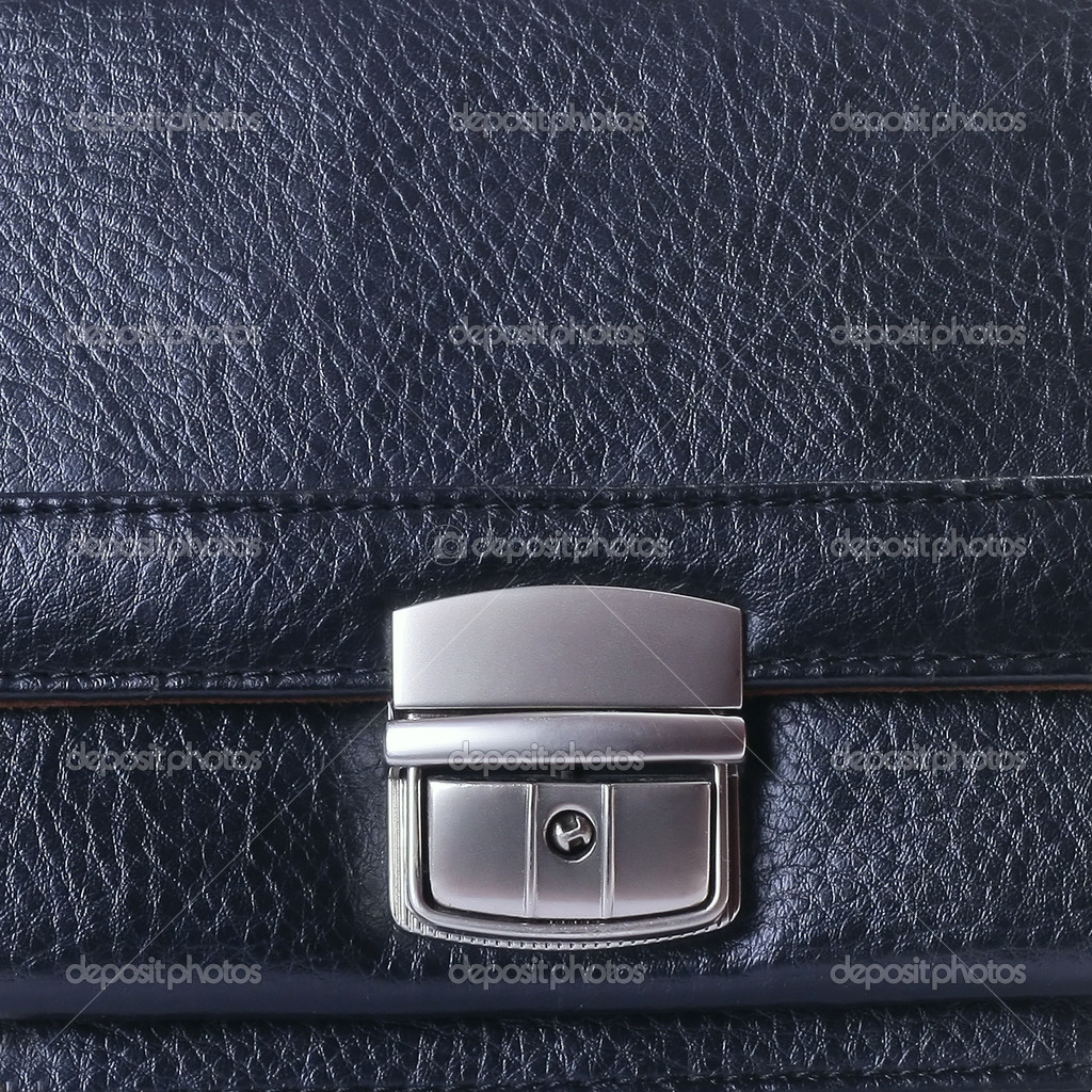 Metal lock on leather bag — Stock Photo #8153839