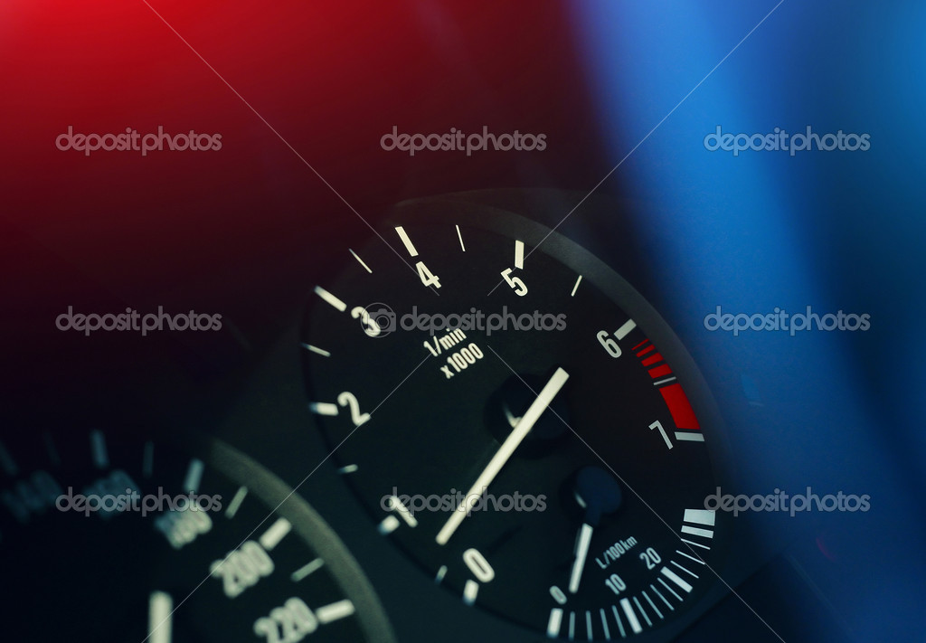 Scales of devices on a car dashboard with colored lights — Stock Photo #8154675