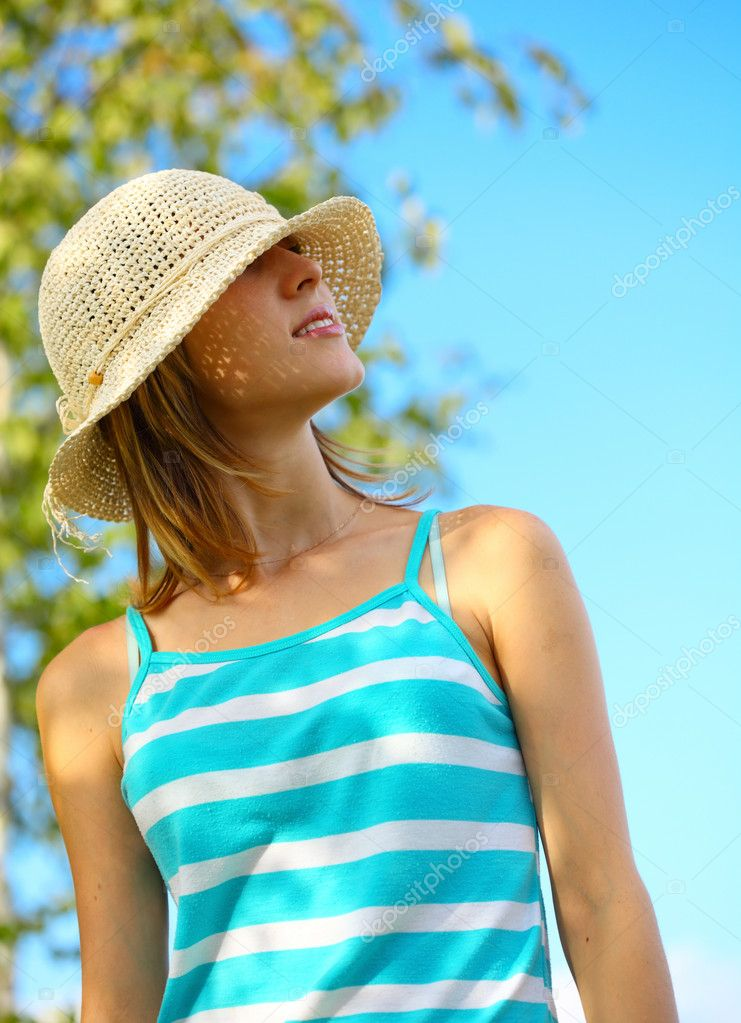 Young woman in straw hat on blue sky background  Stock Photo #8157510