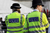 Politie vrouw en politie politieman in londen — Stockfoto