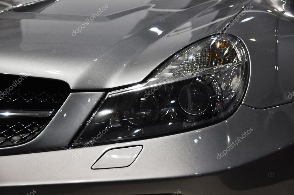 Sports car headlight — Stock Photo #8042975