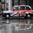 Vodafone advertisement on a black cab - Stock Photo