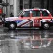 Foto de Stock  : Vodafone advertisement on black cab