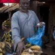 Shopkeeper selling plantain in Bamako — Stok fotoğraf