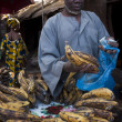Stock Photo: Shopkeeper selling plantain in Bamako