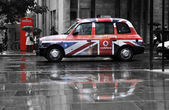 Vodafone advertisement on a black cab — Photo