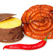 Packaged cheese, smoked sausage and red pepper pod of dark on a — ストック写真
