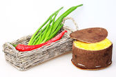 Basket with green onions and red peppers, cheese packaging made — Stock Photo