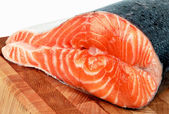 A piece of salmon in the fish section on a cutting board — Stock Photo