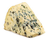 Slice of Roquefort cheese on white background — Stock Photo