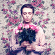 Young beautiful man with flowers - Stockfoto