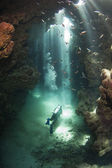 Scuba diver in an underwater cave — Стоковое фото