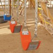 Swings in a childrens play area — Stockfoto