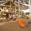 Climbing frame in a childrens play area — Stock Photo #8068487