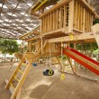 Climbing frame in a childrens play area — Stockfoto