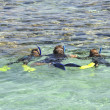 Stock Photo: Family snorkeling in tropical lagoon