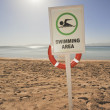 Swimming sign on a tropical beach — Lizenzfreies Foto