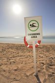 Swimming sign on a tropical beach — Stock Photo