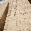 Egyptian hieroglyphic carvings on a temple wall — Foto Stock
