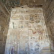 Egyptian hieroglyphic carvings on a temple wall — 图库照片