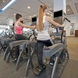Stock Photo: Women on gym machines