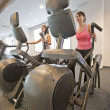 Women on gym machines — 图库照片