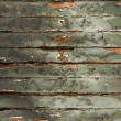 Stock Photo: Old Green chipping wood wall