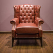Front of Classic Chesterfield luxury Brown Leather armchair — Stock Photo