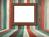 Picture frame on Old wood wall and floor — Stock Photo