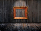 Old picture frame on wooden wall — Stock Photo